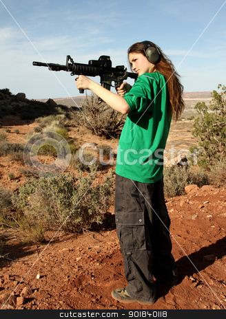 Teenage girl target shooting with rifle. stock photo, Teenage girl shooting at outdoor targets. by asbasb