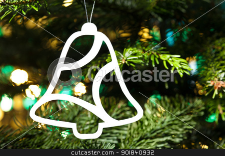 Bell shape Christmas ornament in Christmas tree stock photo, Bell shape Christmas ornament in fresh green Christmas tree by Ulrich Schade