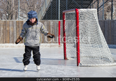 Little girl skating stock photo, Little girl skating at an outdoor skating rink. by Click Images