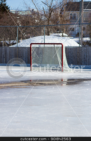 Ice hockey net on melting ice stock photo, Ice hockey rink with hockey net on melting ice in the early spring. by Click Images