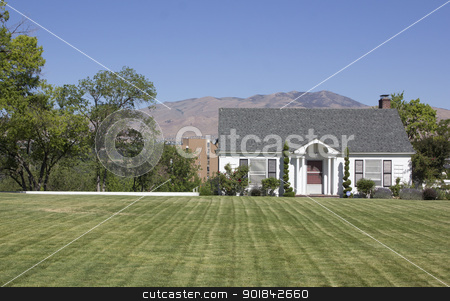 Small country home stock photo, a small country home with perfect green grass. by Jeremy Baumann