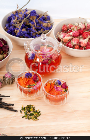 Herbal natural floral tea infusion with dry flowers stock photo, Herbal natural floral tea infusion with dry flowers ingredients by Francesco Perre