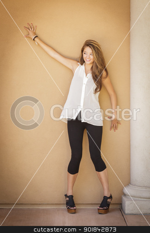 Attractive Mixed Race Girl Portrait stock photo, Attractive Mixed Race Girl Portrait Outdoors Standing Against Wall. by Andy Dean