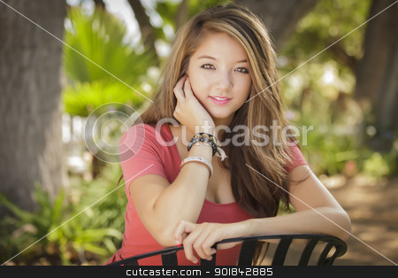 Attractive Mixed Race Girl Portrait stock photo, Attractive Mixed Race Girl Portrait Sitting Outdoors. by Andy Dean
