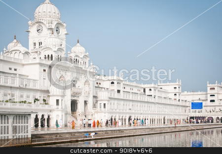 Harmandir Sahib Complex stock photo, Amritsar, India - August 26, 2011: Pilgrims walk in the Harmandir Sahib Complex, the spiritual and cultural center of the Sikh religion by Iryna Rasko