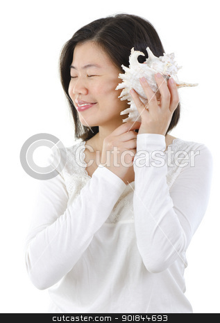 Listening to a seashell stock photo, Asian female listening to a seashell over white background by szefei