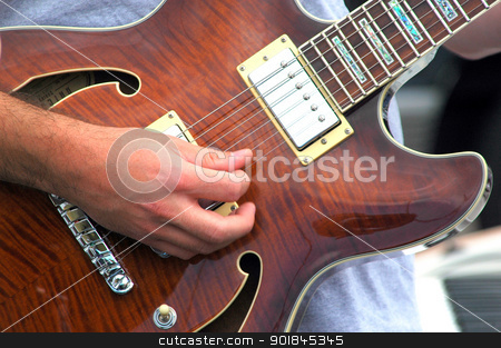 Guitarist. stock photo, Guitarist performing on stage in concert. by OSCAR Williams