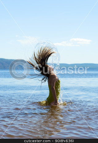 Playing with water stock photo, Child in the water waving hair by Imaster