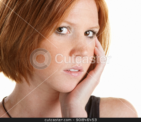 Thinking Lady with Hand on Face stock photo, Pretty Caucasian woman with hand on face staring ahead by Scott Griessel