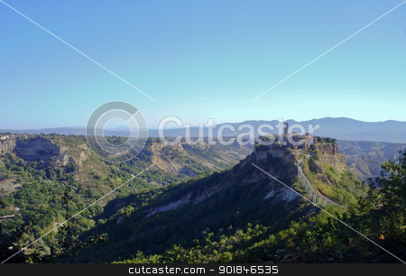 The Italian hill town of Civita di Bagnoregio  stock photo, The Italian hill town of Civita di Bagnoregio rests quietly on a hilltop created by earthquake and erosion. by Click Images
