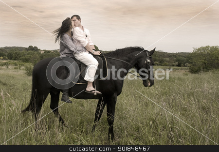 couple and  horse in a field stock photo, beautiful black stallion in a field with young couple, vintage effect by Bonzami Emmanuelle