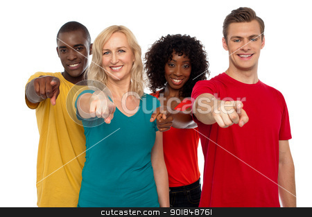Team of smiling teenagers indicating at you stock photo, Team of smiling teenagers indicating at you isolated over white background by Ishay Botbol