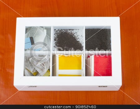 Teabags stock photo, Six different kinds of tea inside a white bax by Fabio Alcini