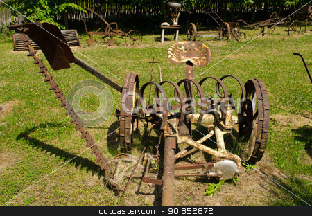 retro grass cut harvest agriculture machinery  stock photo, Vintage rusty grass cutting and harvesting agricultural machinery equipment.  by sauletas