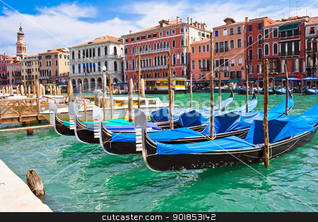 Venetian gondolas stock photo, Beautiful gondolas anchored in Venice, Italy by Alexey Popov