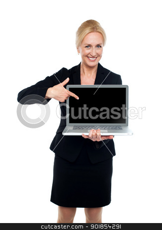 Business lady indicating towards laptop screen stock photo, Smiling business lady indicating towards laptop screen isolated over white background by Ishay Botbol