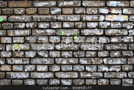 Aged brick wall background  stock photo, Old paper ads on aged brick wall by nvelichko