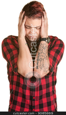 Man Grabbing His Head stock photo, Young man in flannel grabbing the sides of his head by Scott Griessel