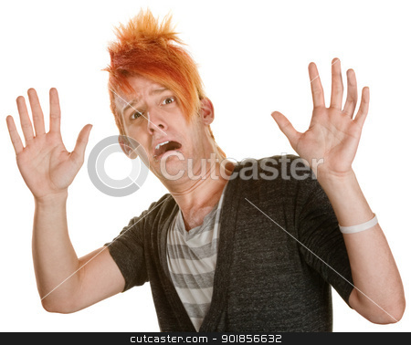 Frightened Man in Orange Hair stock photo, Frightened man in orange spiky hair with hands up by Scott Griessel