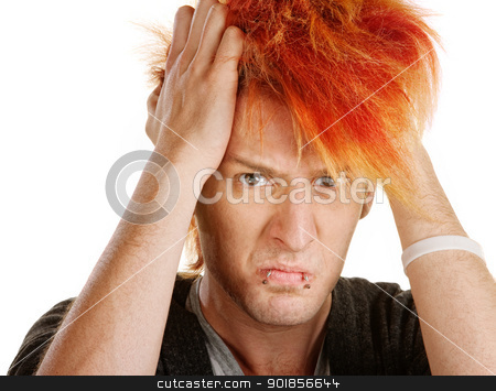 Angry Teen Pulling Hair stock photo, Angry young man pulling his orange hair by Scott Griessel