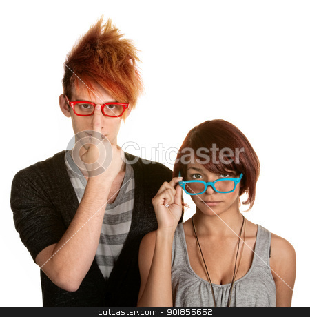 Eccentric Couple Adjusting Glasses stock photo, Awkward male and female teenager adjusting their glasses by Scott Griessel