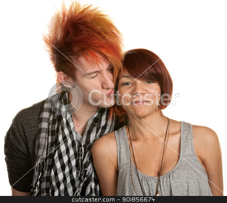 Young Man Kissing Girlfriend stock photo, Young man with mohawk kisses mixed girlfriend over white by Scott Griessel