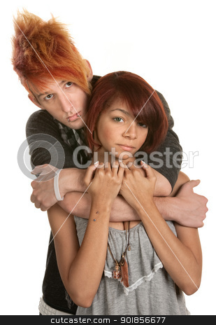 Sad Young Couple Embrace stock photo, Sad young couple embrace over white background by Scott Griessel