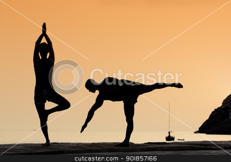 yoga exercise stock photo, healthy couple doing yoga exercises outdoors by mandygodbehear