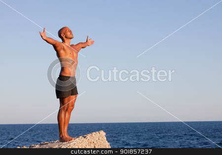 summer man stock photo, summer man with arms outstretched on vacation by mandygodbehear