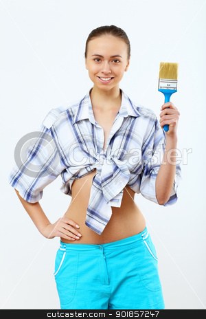 Woman with paint brushes stock photo, Portrait of young woman with paint brushes by Sergey Nivens