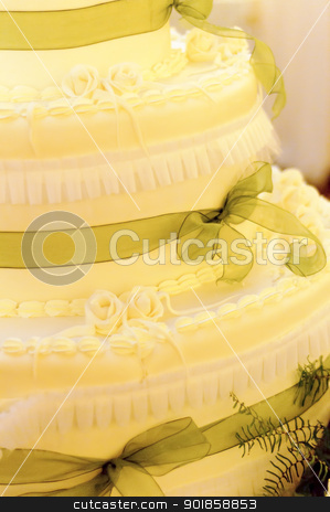 Wedding cake stock photo, Yellow cream wedding cake with green ribbons by Alessandro Rizzolli
