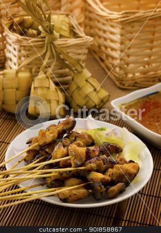 Asian Malay food stock photo, Asian Malay Ramadan food, satay chicken and ketupat in low light by szefei
