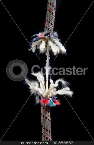Rope is breaking stock photo, A rope is breaking on a black background by Dario Rota