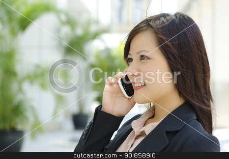 Business communication stock photo, Young Asian business woman talking phone outside modern building by szefei