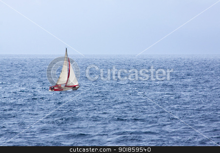 Sail Yacht at Sea stock photo, Yacht with red sail in choppy sea by Darren Pullman