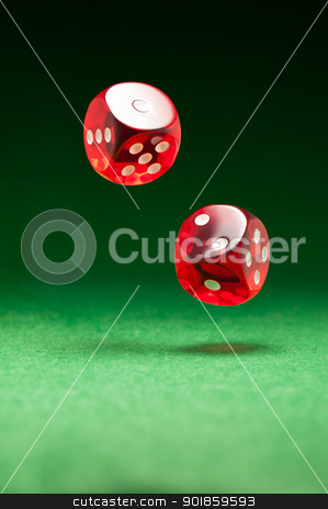 Rolling red dice on a casino table stock photo, Rolling red dice over green surface by Ulrich Schade