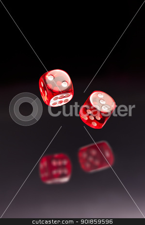 Rolling red dice  stock photo, Rolling red dice over black grey background by Ulrich Schade