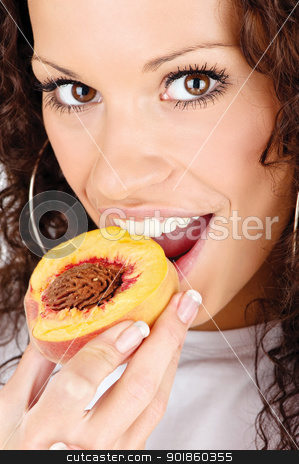 woman eating peach stock photo, Close up of a pretty woman eating slice of peach by iMarin