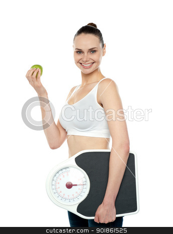 Attractive woman with apple and weight scale stock photo, Attractive woman with apple and weight scale smiling at camera by Ishay Botbol