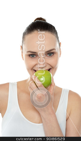 Closeup portrait of beautiful woman eating green apple stock photo, Closeup portrait of beautiful woman eating fresh green apple isolated against white background by Ishay Botbol