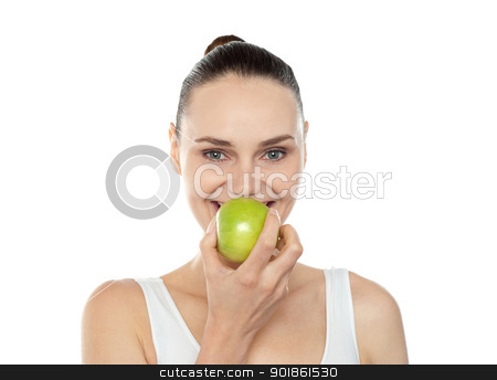 Attractive girl eating fresh juicy green apple stock photo, Attractive girl eating fresh juicy green apple. Close up portrait by Ishay Botbol
