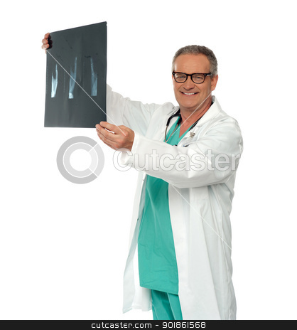 Smiling doctor in glasses reviewing x-ray report stock photo, Smiling doctor in glasses reviewing x-ray report of a patient by Ishay Botbol