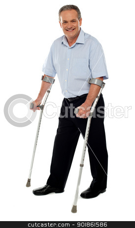 Senior man standing with the help of crutches stock photo, Senior man standing with the help of crutches. Recovering from an accident by Ishay Botbol