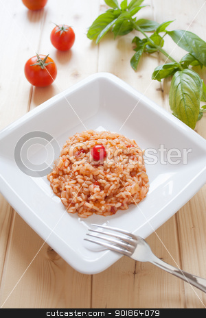 Risotto al pomodoro stock photo, Dish of tomatoes risotto on wood table by Giordano Aita