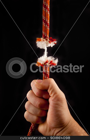 Rope is breaking  stock photo, A red rope is breaking on a black background by Dario Rota