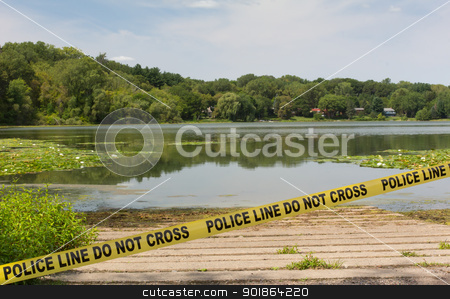Crime Scene Tape stock photo, Police warn passers-by to stay away from the lake. by Ken Wolter