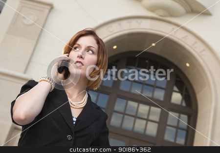 Young Businesswoman On Cell Phone in Front of City Hall stock photo, Proud Serious Young Pretty Businesswoman On Cell Phone Outside in Front of City Hall Building. by Andy Dean