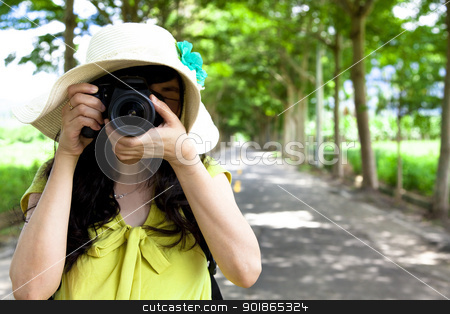 Young traveler taking photo in the green forest stock photo, Young traveler taking photo in the green forest by tomwang