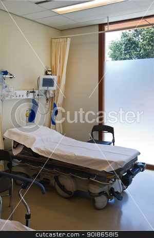 First aid in hospital with bed and medical equipment stock photo, First aid in hospital with bed, monitor and medical equipment by Colette Planken-Kooij