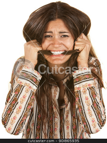 Frantic Woman Biting Her Hair stock photo, Frantic young woman biting on her long hair by Scott Griessel